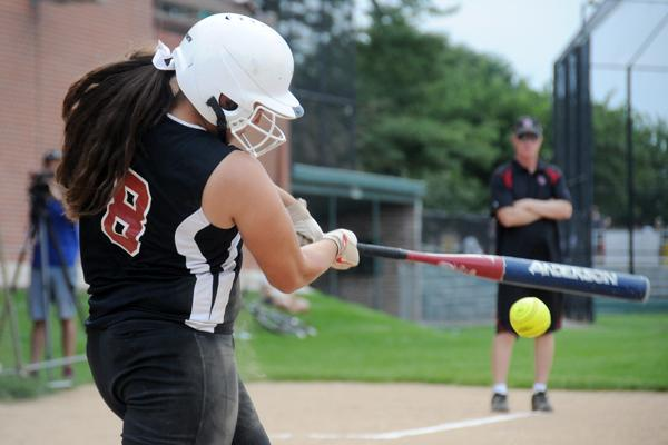 3rd Year varsity softball player Angela Cordova swinging for the fences!