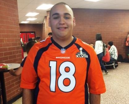 Junior, Jesus Torres wearing a Peyton Manning jersey (Briana Garcia)