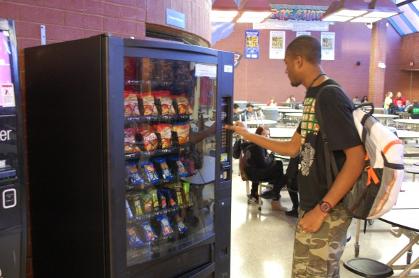 Aron Shells buys snacks from a vending machine in the commons (Taken by Jonathan Headley)