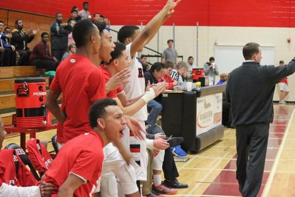 Rangeview+Varsity+Boys+Basketball+team+celebrates+a+three+shot+by+Junior+guard+Tyrei+Randall.