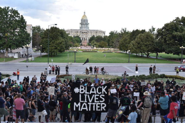 Jessica+Land+holds+sign+in+support+of+the+Black+Lives+Matter+movement+outside+of+Denver+capitol+building.+This+protest+took+place+July+2016+after+shootings+in+Louisiana+and+Minnesota+%28Patrick+Traylor%29.