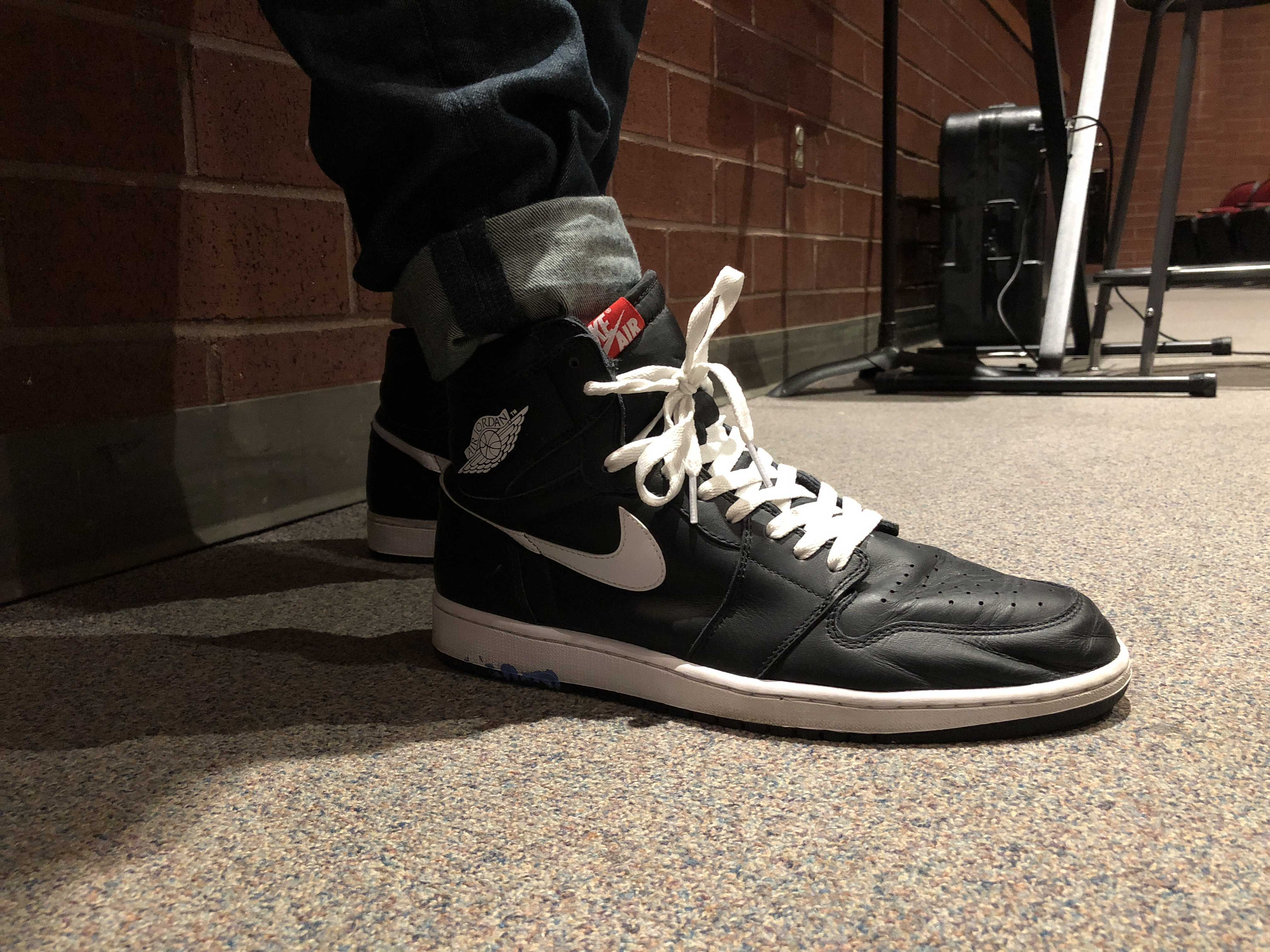 Feature Photo By: Yucheng Zhang - Senior Spencer Reagan showing off his Jordan 1's.  Reagan enjoys these particular shoes immensely, and plans to utilize them throughout the fall.