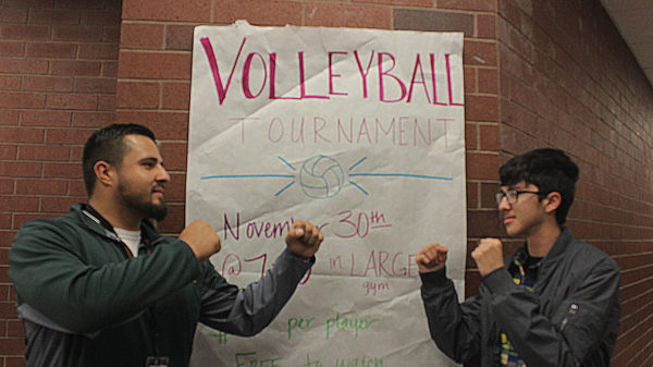 Senior+Kevin+Armendariz+and+staff+Mr.+Gonzalez+pose+in+front+of+the+volleyball+tournament+poster.+The+tournament+is+tonight%2C+6%3A30+for+registration+and+begins+at+7%3A00.+