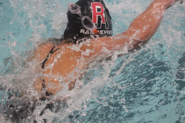 Alasiah Murray pushes through the 400 freestyle relay without goggles on. She was unable to complete her 100 due to her breathing.
