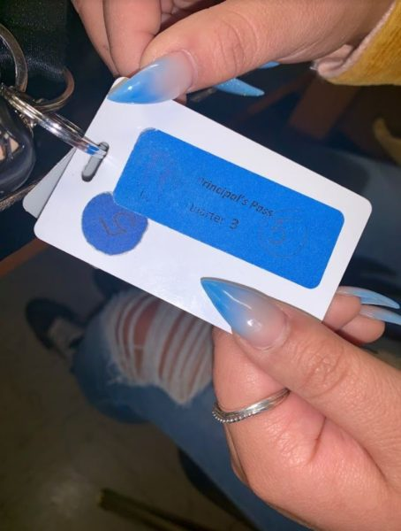 """Adeleen Quiroz holds her principals pass. """"I'm not always asked for my pass, so I guess, at the moment, they seem kind of pointless."""""""