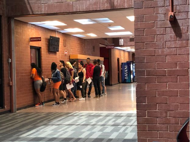 """Featured Photo by: VeThalia Warren - Seniors line up while they get their check out sheets approved and stamped by the bookkeeper during 6th period.Senior Zahla Neal-colemen exclaims,"""" I just feel really excited and happy but I'm also very sad. I'm happy because this means I'm going to start the next chapter of my life, going off to college and being on my own. But I'm very sad because this means that I'm leaving all my juniors, sophomores, and freshmen friends behind."""""""