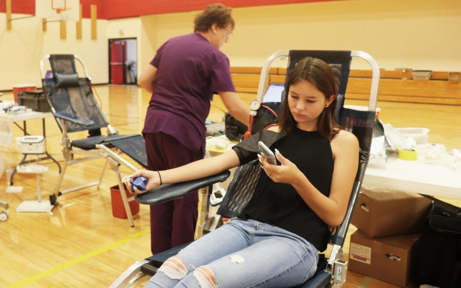 Senior+Lexi+Glowon+donated+blood+on+Tuesday%2C+August+27th+during+the+annual+RHS+blood+drive.+This+blood+drive+was+held+by+the+Rangeview+student+leadership.