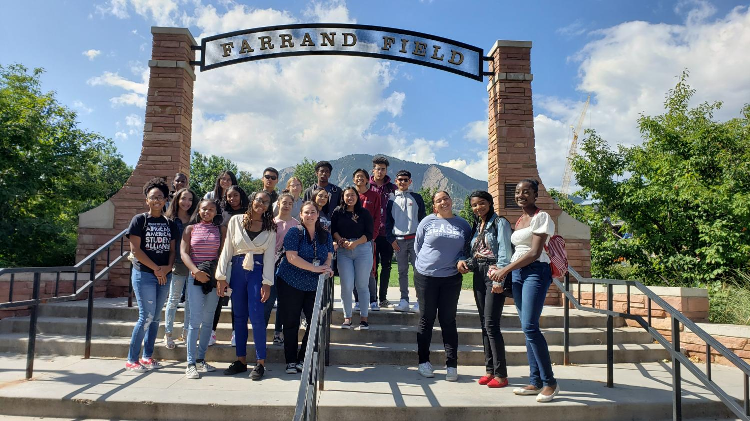 Feature photo by Shauna Meyer: A group photo of a handful of students at Farrand Field during the CU Boulder college visit.
