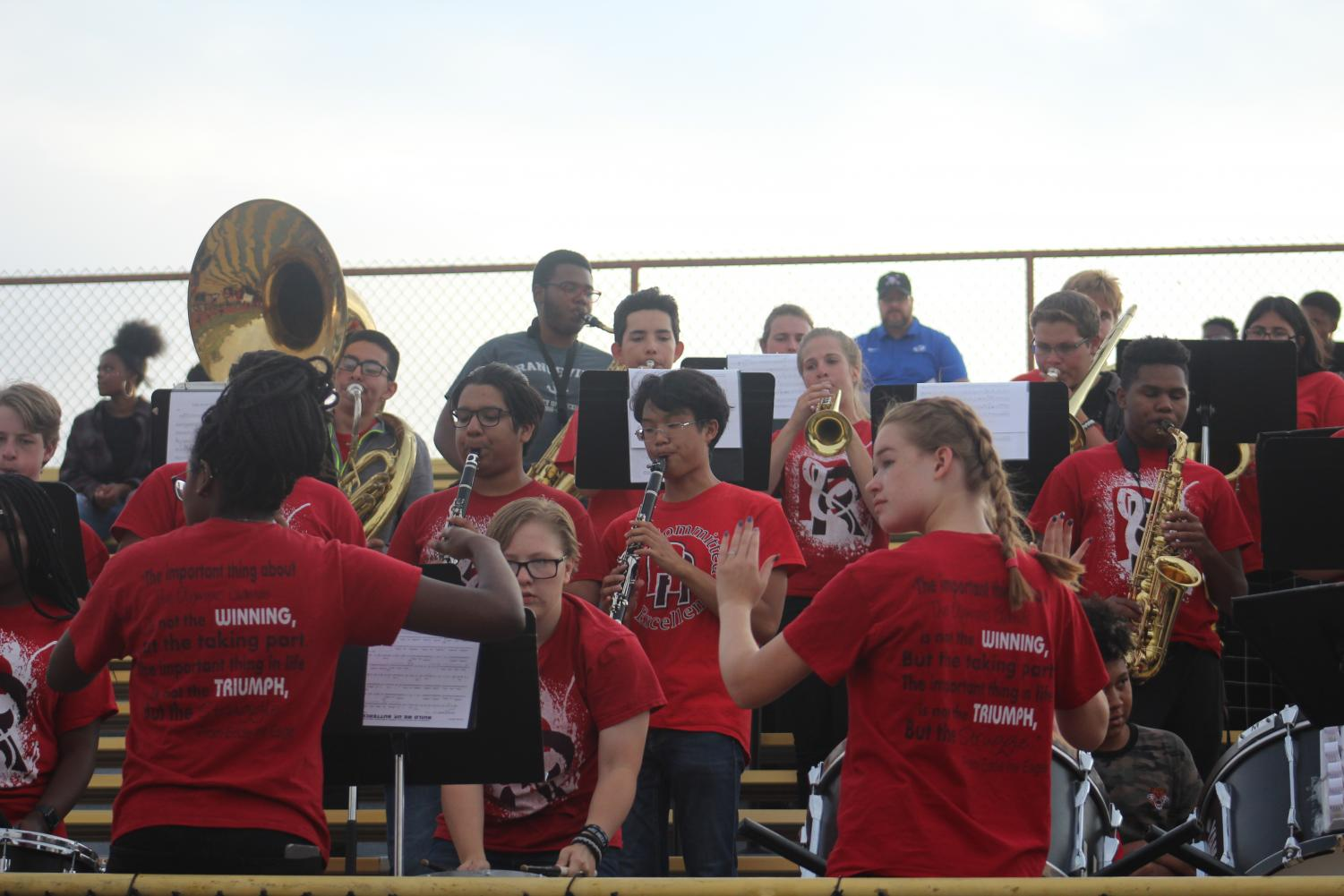On the left, Senior Aida Wates and on the right, Senior Katie Finell conduct the band while they played the RHS Fight Song after a touchdown on the football game on Thursday.
