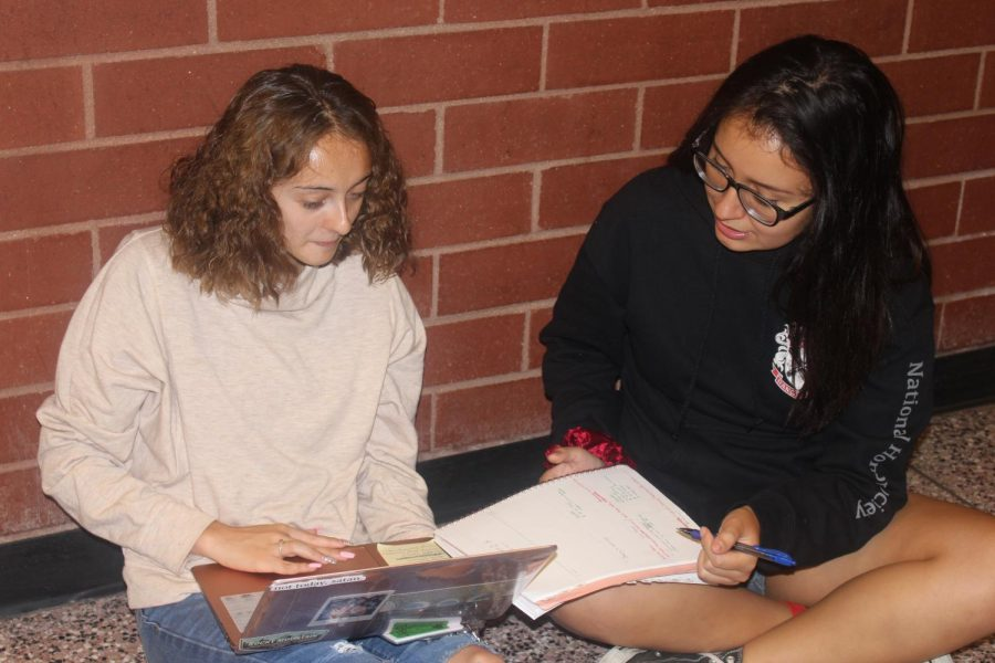 Myriam Alcala(right), senior and Editor in Chief of the Raider Review sits with Jessenia Jaime Delgado(left), senior, to give her a final revision on her story before it gets posted. (Melanie Aguirre)