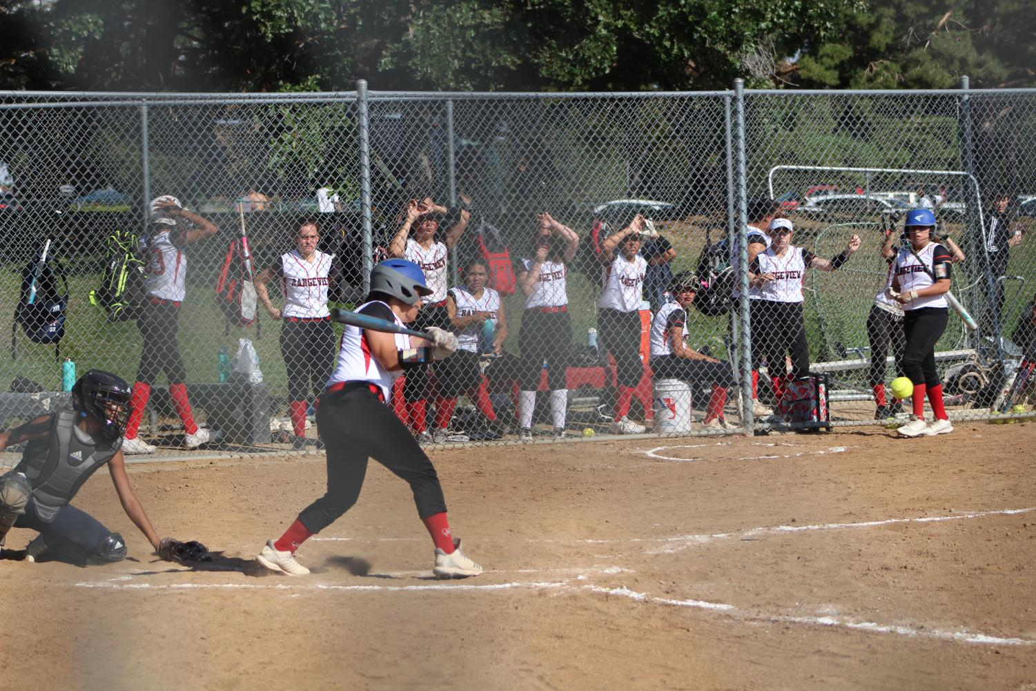 Senior Janeigh De La Paz steps up and swings in the first game of the season vs. Kennedy. Rangeview won with an ending score of 12-8.