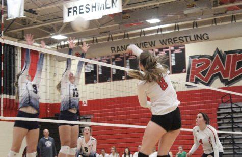 Alli Powell spikes the ball against the opposing team Dakota Ridge.