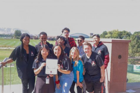 Students representing the Raider Review and Yearbook pose after the conclusion of J-Day. The Review won All Colorado for Online News.