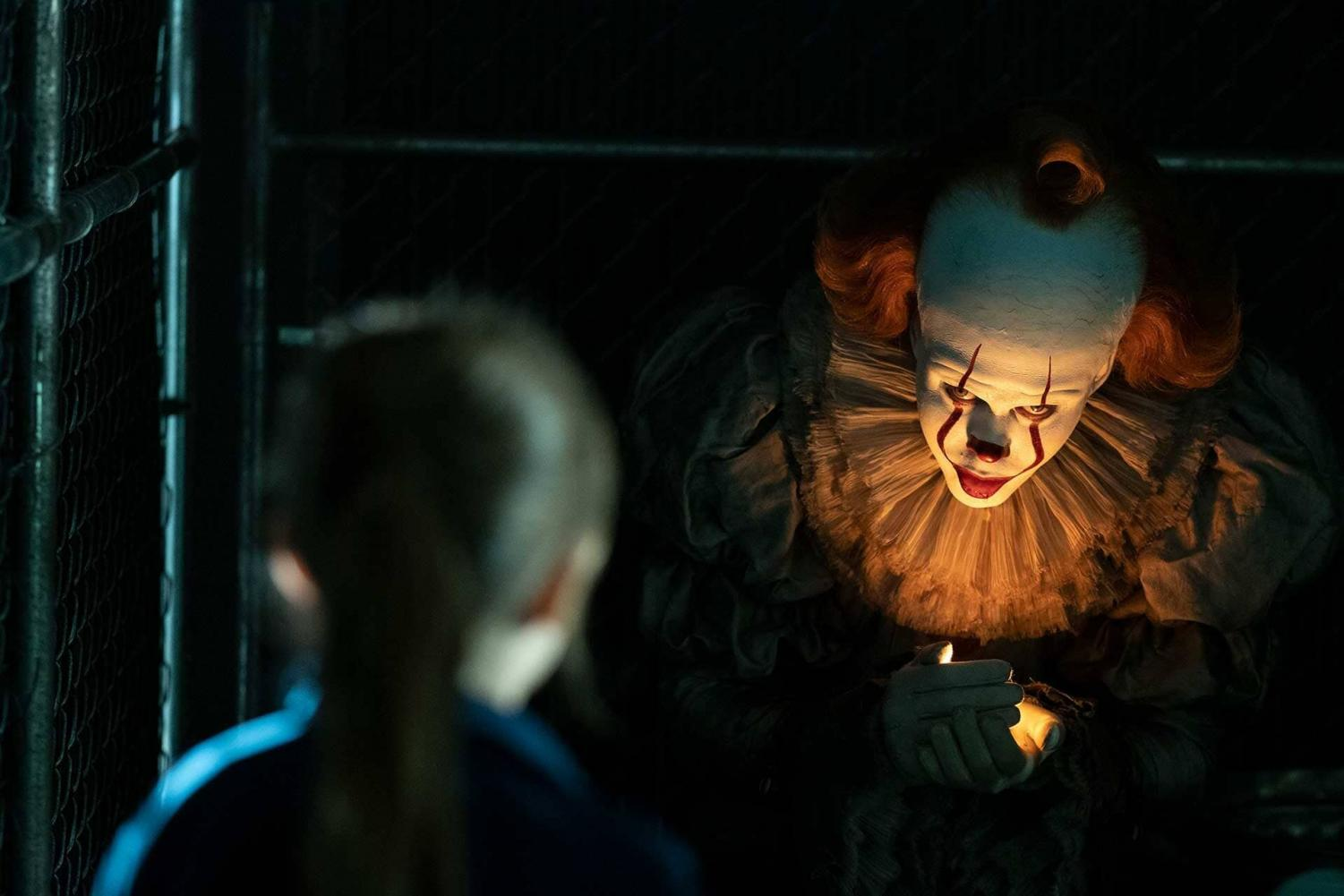 Pennywise uses a lightning bug to lure a little girl into his grasp. (Photo by Warner Brothers)