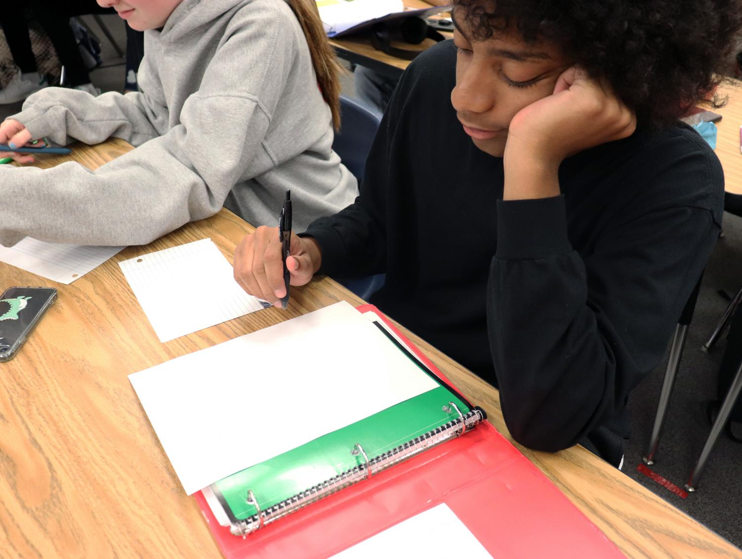 """Junior, Yashua Mujib works on an English assignment in AP Lang on September 17, 2019. """"It's only been two months into junior year, and I already feel overwhelmed."""""""