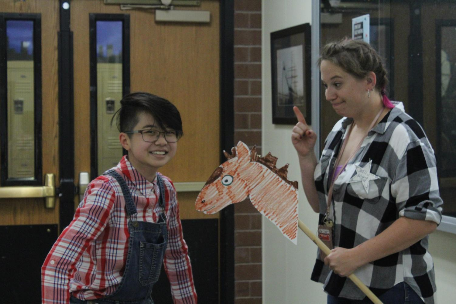 Teacher Miss Ryan chased around one of her art students, junior Glenda Chiang with her best pal, her horse.