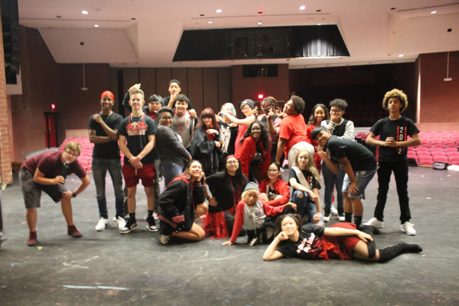 The variety of students from the Master Acting Class — MAC — pose for a group photo in their Rangeview inspired wear.