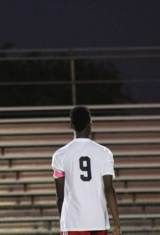 Rashid Seidu-Aroza looks towards the stands as he catches his breath.