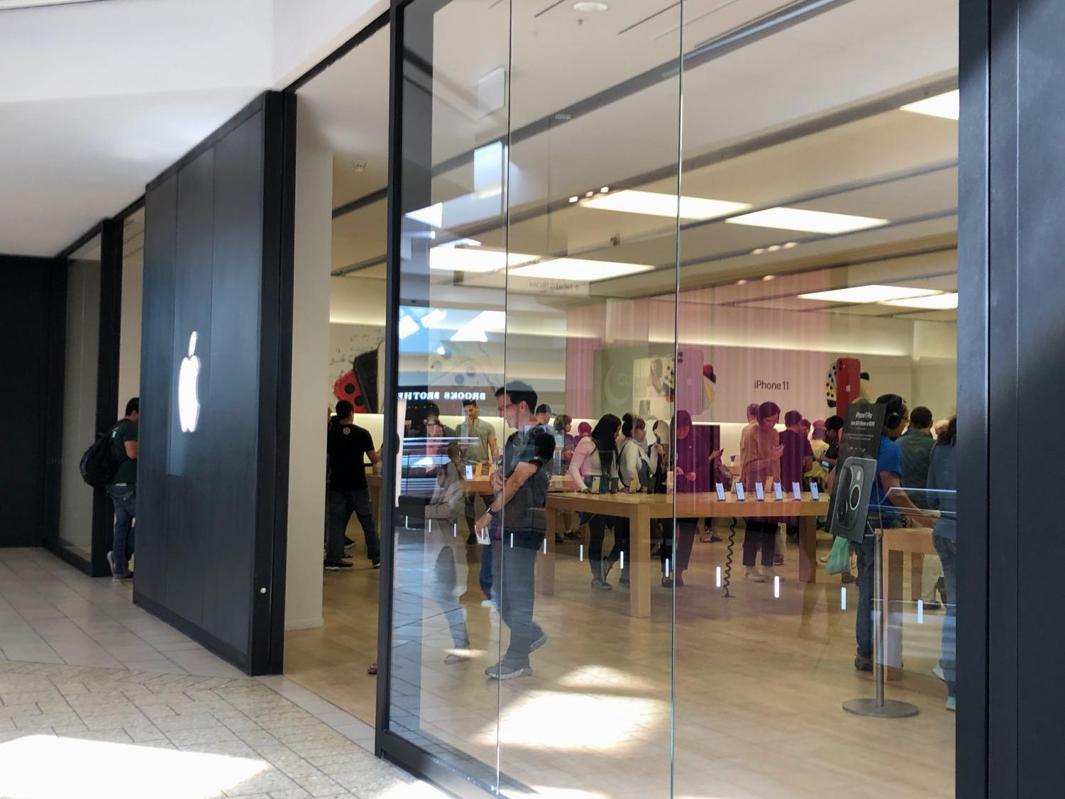 The Apple store in the Cherry Creek mall is filled with awaiting customers looking at the many products they sell. (Stephanie Pickens)