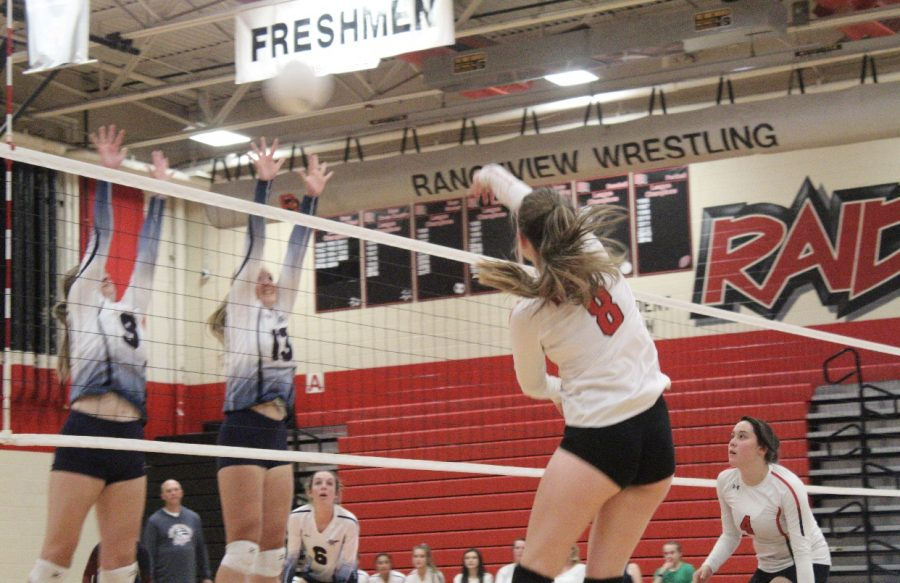 Allison Powell spikes a ball in another season of EMAC dominance for volleyball. Volleyball is just one of the many Rangeview sports dominating the EMAC competition.