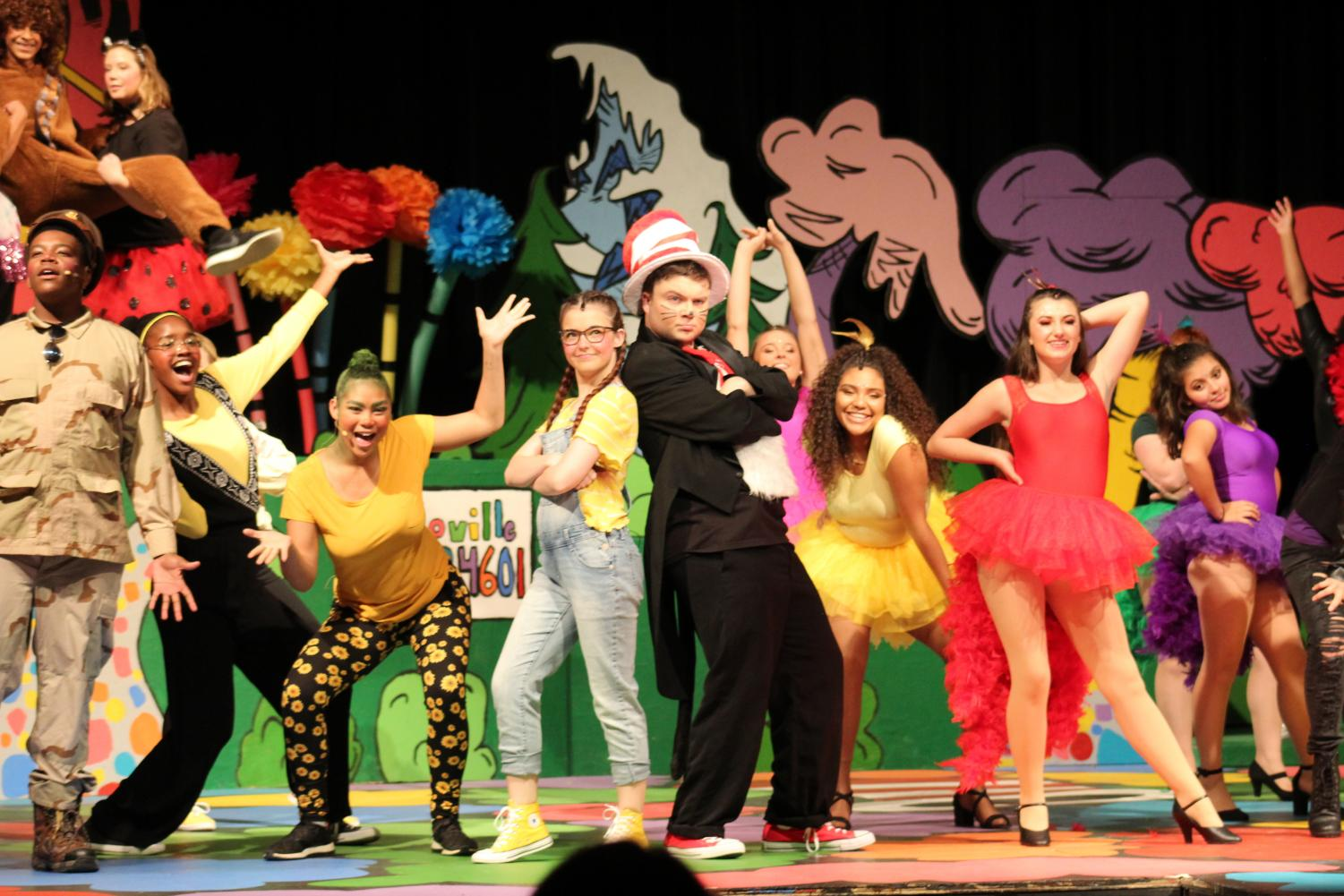 The cast of Seussical performs on stage. The Whos, Cat in the Hat, Jojo, the birds, and other various characters dance and sing to one of the songs. (Alexis Drummond)