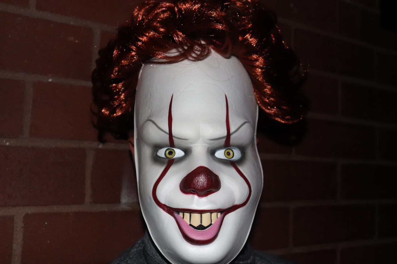 Feature Photo: Toli Geshow -  Freshman Khiem Davidson acts as a clown for the freshman class' escape room.
