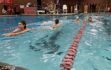 The girls swim team at practice on December 10th. The girls had a kick drill that day. (Katiana Williams)