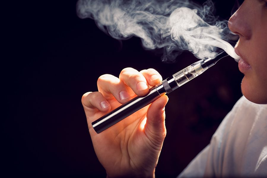 The legal age is now 21 years old to purchase tobacco products, such as the e-cigarette pictured. (Getty Images)