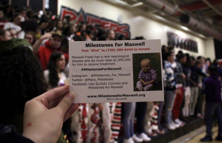 "Everyone in the crowd during Saturday's basketball team held ""Milestones for Maxwell"" cards. (Vivian Tran)"