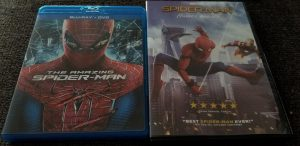 A comparison between The Amazing Spider-Man and Spider-Man: Homecoming's movie cases. Both are very colorful, but differ in the mood, as The Amazing Spider-Man is darker.
