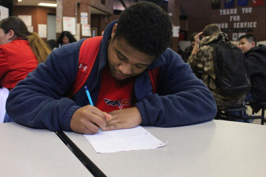 Senior student athlete Nicholas Green does homework during his off period. He is set to play football at Concordia University. (Jeffrey Afriyie)