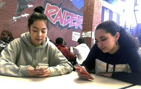 Feature Photo by: Melanie Aguirre - Denise Arreola (left) and Marwa Ait Chafhi (right) spend lunch together as they go through their social media.