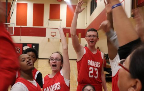 Feature Photo by Brianna Sanchez - Freshman Jordan Lewis leads a cheer before the Unified Basketball game on Tuesday. (Brianna Sanchez)