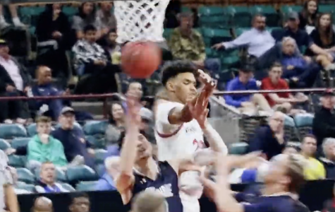 Christopher Speller battles for a rebound in Rangeview's Great 8 victory over Columbine.