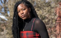 Salmata poses for a photo that captures the best lighting at the signature photo spot for most Rangeview seniors. This is her last photo taken on Rangeviews campus. (Salmata Soulemane)