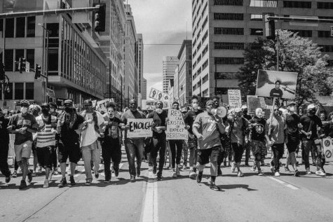 Protestors march down 16th Street in Denver (Peter Vo)