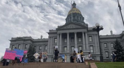 A small amount of citizens are gathered at the Capitol in Denver to spread awareness about human trafficking (NewsBreak)