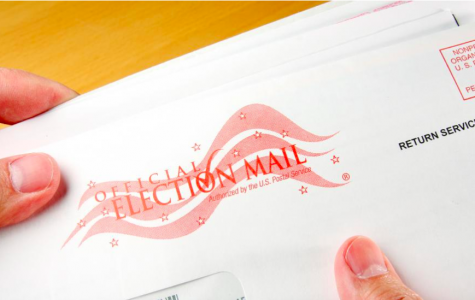 Image shows a potential voter holding an election ballot. Voting via mail has always been an option, but now due to COVID-19, it will become one of the most used forms of voting by students.