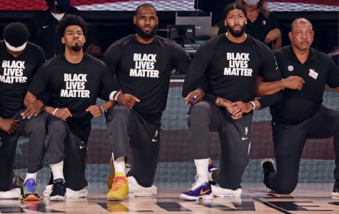 The Lakers and Clippers kneel together before their match-up in the Orlando Bubble. Teams are wearing Black Lives Matter shirts during all pre-game activities.