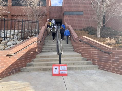 Student use the Journalism/Social Studies entrance. They take their ten minute break outside. (Caroline Smith)