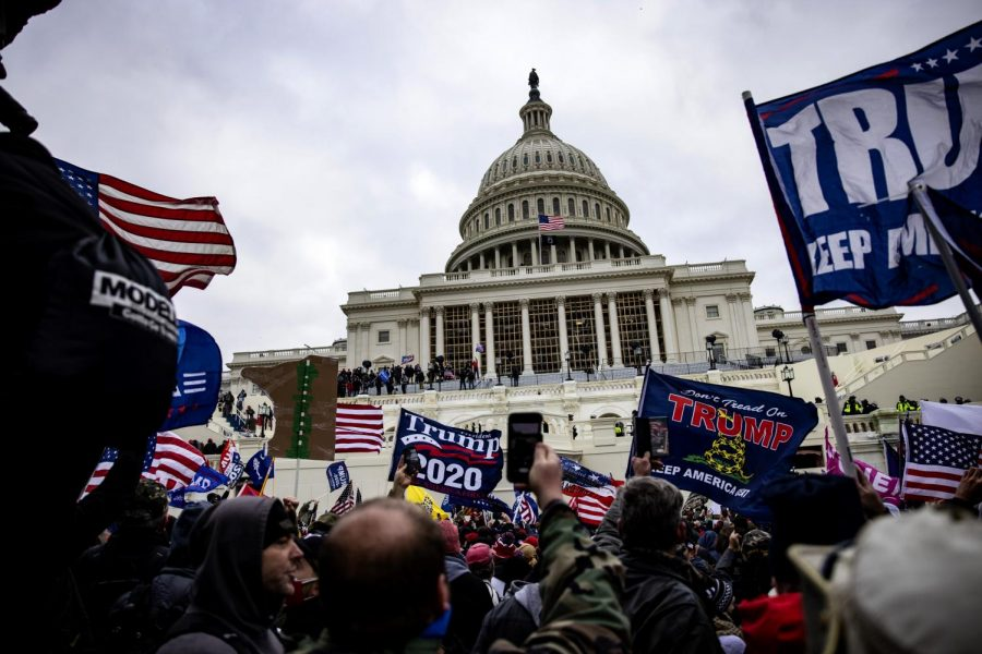 Trump supporters wave their flags as they storm the U.S. Capitol (Getty Images)