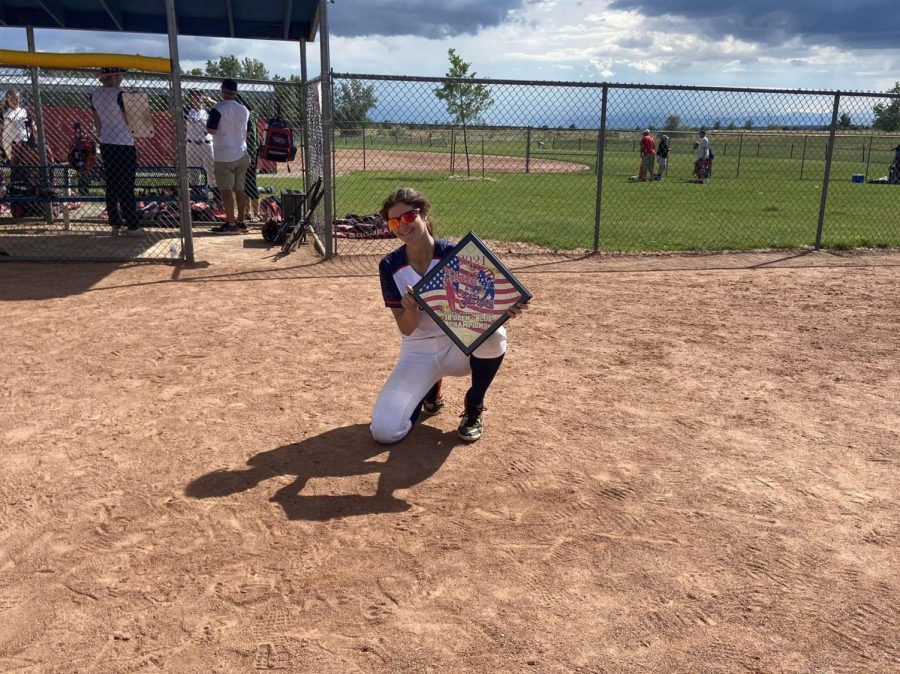 Lyster shows off her trophy for one of her softball tournaments.