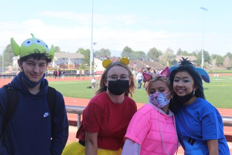 Seniors Jake Bonansinga, Hannah Bonansinga, Nicole Parada, and Vivian Tran pose for a picture during the lunchtime game. Three of them dressed as Winnie the Pooh and friends Piglet, and Eeyore. (Sariah Williams)