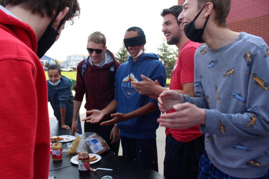 Senior Nabil Djaber and his friends laugh as they participate in Linguini's Lunch Rush. (Aubry Vigil)