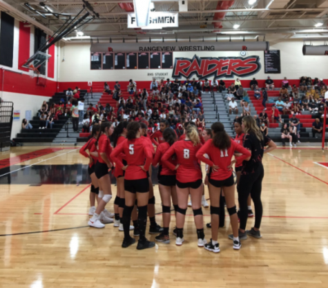 Rangeview Girls Volleyball meets in a huddle in game vs Thomas Jefferson High School on August 31, 2021.